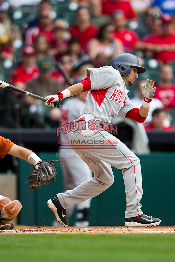 Houston Cougars second baseman Josh Vidales #8 follows through on his swing during the NCAA baseball game against the Texas Longhorns on March 1, 2014 during the Houston College Classic at Minute Maid Park in Houston, Texas. The Longhorns defeated the Cougars 3-2. (Andrew Woolley/Four Seam Images)