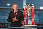 The First Minister for Wales Mark Drakeford looks at the Six Nations trophy during the welcome event for the Wales's national rugby team who won both the Six Nations and the Grand Slam at the National Assembly for Wales Senedd building in Cardiff Bay today for a public celebration event.