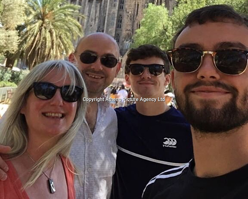 Pictured: Family handout picture of Ifan Owens (R) with mum Mari, dad Gareth and brother Tomi.<br /> Re: Five men have been sentenced after admitting their part in an attack which left 20 year old university student Ifan Owens in a coma.<br /> Ifan Owens, 20, from Cardiff, was attacked and found unconscious on High Street, Aberystwyth, on 14 January 2018.<br /> Billy Valentine, 19, pleaded guilty to causing grievous bodily harm with intent at a previous hearing and was sentenced to seven and a half years at a young offenders' institution.<br /> David Robert Lloyd, 25, of no fixed address, was jailed for three years and eight months; Lee Andersen, 20, of Newcastle Emlyn, received a 25-month jail term; and both Andrew Raymond John Scott, 23, of Llangwyryfon, and Michael Jones, 24, of Llanfair Clydogau, received 30-month sentences.