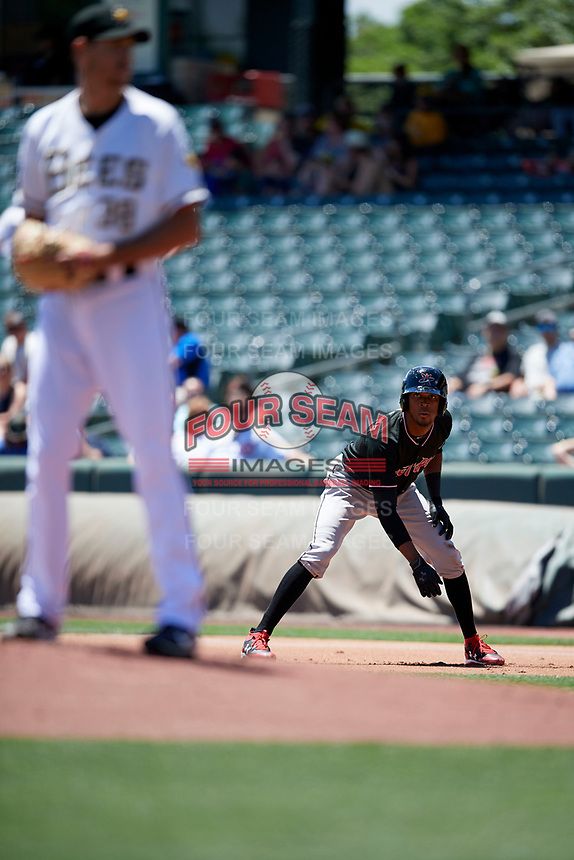 Rosell Herrera (7) of the Albuquerque Isotopes  takes his lead in Pacific Coast League action at Smith's Ballpark on June 11, 2017 in Salt Lake City, Utah. The Bees defeated the Isotopes 6-5. (Stephen Smith/Four Seam Images)