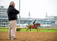 Shug McGaughey, trainer of probable Kentucky Derby favorite Orb, watches his horses exercise at Churchill Downs during Derby Week April 29, 2013.