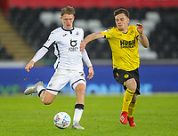 23rd November 2019; Liberty Stadium, Swansea, Glamorgan, Wales; English Football League Championship, Swansea City versus Millwall; George Byers of Swansea City and Ben Thompson of Millwall jostle for the ball - Strictly Editorial Use Only. No use with unauthorized audio, video, data, fixture lists, club/league logos or 'live' services. Online in-match use limited to 120 images, no video emulation. No use in betting, games or single club/league/player publications