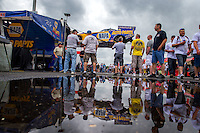 Jun 6, 2015; Englishtown, NJ, USA; The car of NHRA funny car driver Ron Capps is unloaded by crew members in the pits during qualifying for the Summernationals at Old Bridge Township Raceway Park. Mandatory Credit: Mark J. Rebilas-