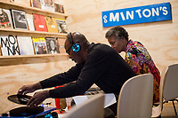 Darryll Vanne and his wife Arona McNeill-Vanne listen to Thelonious Monks albums at a listening station during the Monk @ 100 festival at the Durham Fruit and Produce Company in Durham, NC Wednesday, October 25, 2017. (Justin Cook for The New York Times)