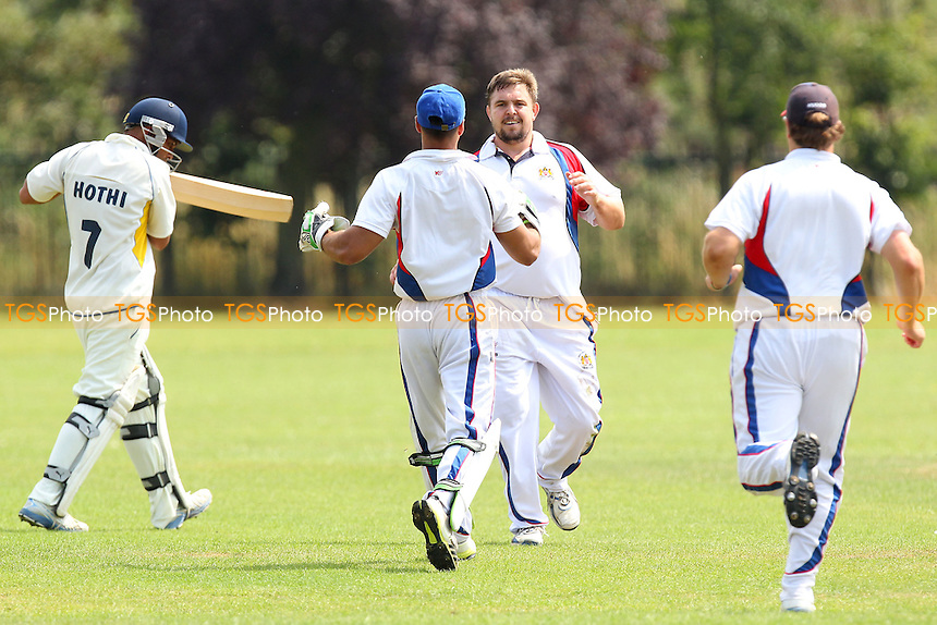 Neil Hutchison of Hornchurch Athletic celebrates taking the wicket of Jas Hothi - Rainham CC (batting) vs Hornchurch Athletic CC - Mid-Essex Cricket League at Spring Farm Park - 19/07/14 - MANDATORY CREDIT: Gavin Ellis/TGSPHOTO - Self billing applies where appropriate - contact@tgsphoto.co.uk - NO UNPAID USE