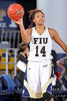 28 November 2010:  FIU player Rakia Rodgers (14) passes the ball in the second half as the FIU Golden Panthers defeated the Indiana State Sycamores, 68-47, to win the 16th annual FIU Thanksgiving Classic at the U.S. Century Bank Arena in Miami, Florida.