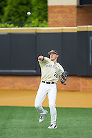 Wake Forest Demon Deacons right fielder Luke Czajkowski (26) warms up in the outfield between innings of the game against the Virginia Cavaliers at Wake Forest Baseball Park on May 17, 2014 in Winston-Salem, North Carolina.  The Demon Deacons defeated the Cavaliers 4-3.  (Brian Westerholt/Four Seam Images)