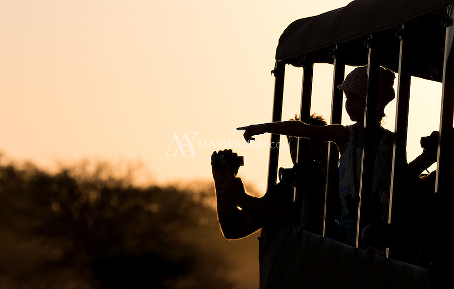 Tourists admire wildlife in Kruger National Park.