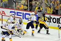 May 31, 2017: Pittsburgh Penguins center Jake Guentzel (59) reacts to a goal against Nashville Predators goalie Pekka Rinne (35) during game two of the National Hockey League Stanley Cup Finals between the Nashville Predators  and the Pittsburgh Penguins, held at PPG Paints Arena, in Pittsburgh, PA. The Penguins defeat the Predators 4-1 and lead the series 2-0. Eric Canha/CSM