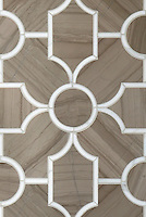 Chatham 3, a waterjet stone mosaic <br /> shown in Driftwood and Calacatta Tia, is part of the Silk Road collection by Sara Baldwin for New Ravenna.