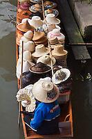 Thai woman selling hats, Damnoen Saduak Floating Market, Damnoen Saduak, Thailand