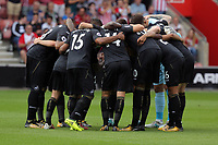 Swansea players huddle before kick off during the Premier League match between Southampton and Swansea City at the St Mary's Stadium, Southampton, England, UK. Saturday 12 August 2017