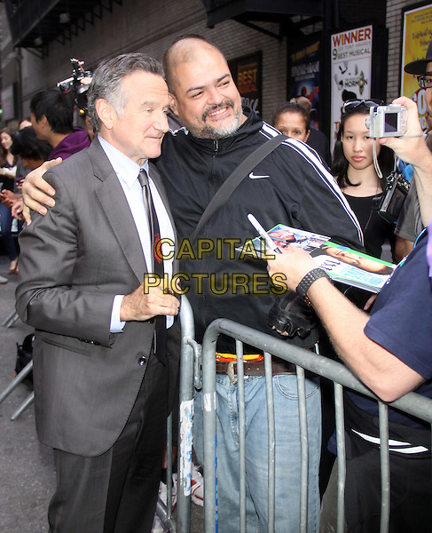 Robin Williams<br /> at the Ed Sullivan Theater for an appearance on Late Show with David Letterman in New York City, USA.<br /> September 25th, 2013 <br /> half length grey gray suit fans crowd signing autographs side profile posing taking picture photograph<br /> CAP/MPC/RW<br /> &copy;RW/ MediaPunch/Capital Pictures