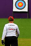 LONDON, ENGLAND 27/08/2012 - Linda Gagnon of the Canadian Paralympic Archery Team walk to the targets to collect arrows during a training session at the London 2012 Paralympic Games at The Royal Artillery Barracks. (Photo: Phillip MacCallum/Canadian Paralympic Committee)