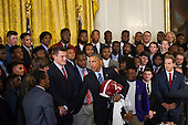 United States President Barack Obama (right) is presented with an Alabama Crimson Tide team football jersey, a helmet and a football, during a ceremony to honor their 2015- 2016 College Football Playoff National Championship, in the East Room at The White House in Washington, D.C., Wednesday, March 2, 2016. <br /> Credit: Rod Lamkey Jr. / Pool via CNP
