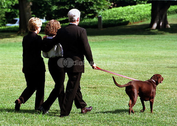 """Buddy"" the dog leads the First Family to Marine 1 on the South Lawn of the White House on August 19, 1999.  The Clintons are to vacation for 2 weeks beginning in Martha's Vineyard..Credit: Ron Sachs / CNP/MediaPunch"