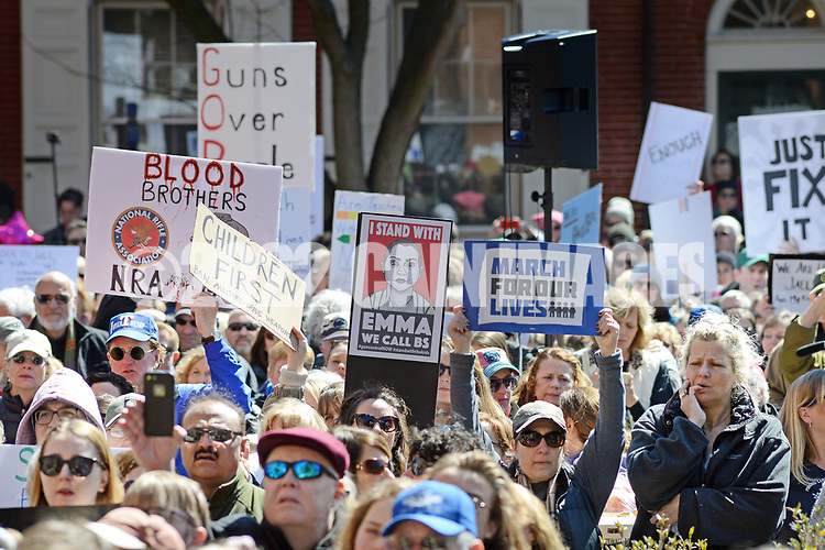 People hold signs during a rally at the old Bucks County Courthouse to protest gun violence and to demand stronger gun control  Saturday, March 24, 2018 during the March For Our Lives in Doylestown, Pennsylvania. (Photo By William Thomas Cain/Cain Images)