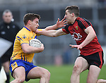Sean Collins of  Clare in action against Jonathan Flynn of Down during their Division 2, Round 2 National League game at Cusack Park. Photograph by John Kelly.