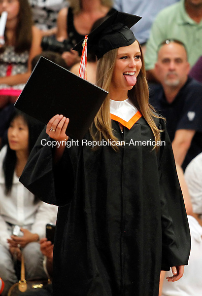 Watertown, CT-18, June 2010-061810CM06  A Watertown graduate stops to joke with friends and family after receiving her diploma Friday night at Watertown High School.   --Christopher Massa Republican-American