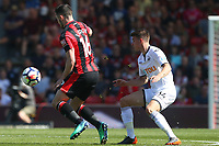 Lewis Cook of Bournemouth is marked by Tom Carroll of Swansea City during the Premier League match between AFC Bournemouth and Swansea City at Vitality Stadium in Bournemouth, England, UK. Saturday 05 May 2018