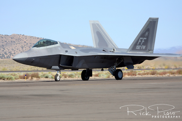 "United States Air Force pilot  Major Paul ""Max"" Moga taxies the F-22 Raptor prior to an airpower demonstration during the 2008 Reno National Championship Air Races at Stead Field in Nevada."