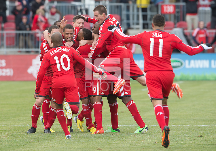 06 April 2013: Toronto FC players celebrate a late equalizing goal by Toronto FC midfielder Darel Russell #16 during an MLS game between FC Dallas and Toronto FC at BMO Field in Toronto, Ontario Canada..The game ended in a 2-2 draw..