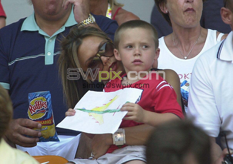 "PIX: Football. Euro 2004. Group B: England-Switzerland, Cidade de Coimbra Stadium, Coimbra, 17th June 2004...COPYRIGHT PICTURE>> SIMON WILKINSON>>0870 092 0092>>..""Look what I drew, Daddy."" Victoria and Brooklyn Beckham."