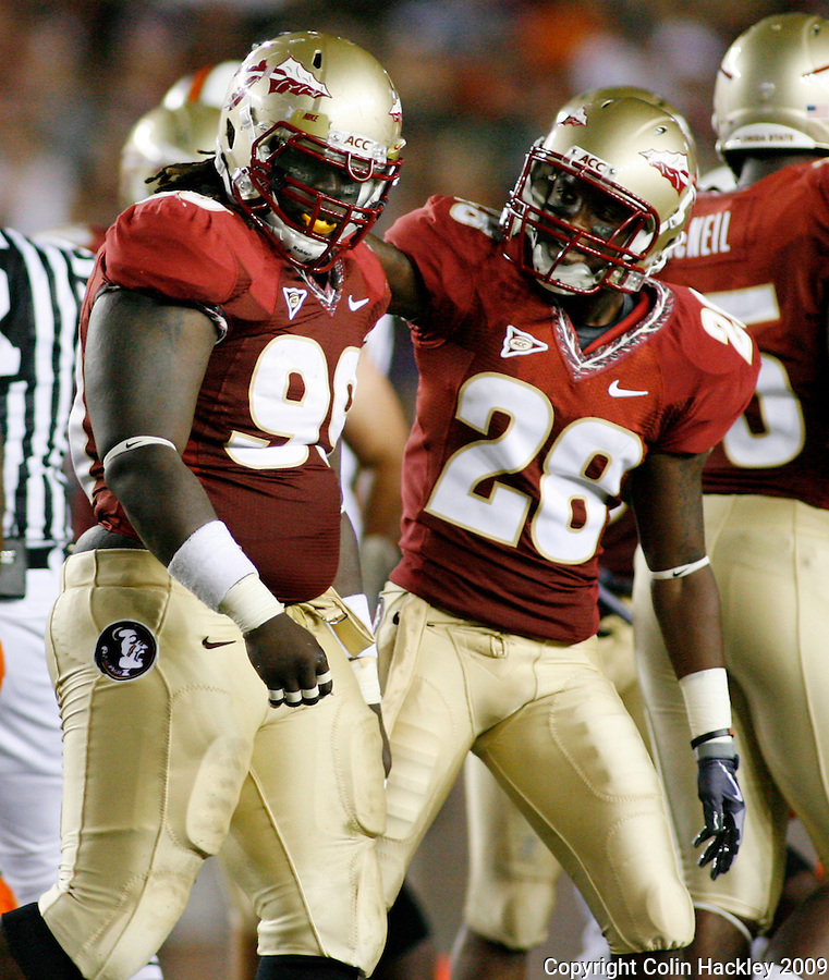 TALLAHASSEE, FL 9/7/09-FSU-MIAMIFB09 CH23-Florida State's Dionte Allen, right, congratulates Jacobbi McDaniel on a tackle during second half action against Miami, Monday at Doak Campbell Stadium in Tallahassee. The Seminoles lost to the Hurricanes 38-34...COLIN HACKLEY PHOTO