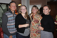 NWA Democrat-Gazette/CARIN SCHOPPMEYER Marty Bryan (from left), Holly Bryan, Holly Bryan and Jenny Bryan help spread good cheer with the Graves Foundation on Dec. 18.