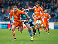 Paris Cowan-Hall of Wycombe Wanderers and Tom Aldred of Blackpool during the Sky Bet League 2 match between Wycombe Wanderers and Blackpool at Adams Park, High Wycombe, England on the 11th March 2017. Photo by Liam McAvoy.