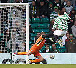 Tony Watt knocks the ball past St Johnstone keeper Alan Mannus to put Celtic briefly ahead