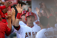 Los Angeles Angels catcher Hank Conger #16 is greeted by his teammates after scoring against the Seattle Mariners at Angel Stadium on July 9, 2011 in Anaheim,California. (Larry Goren/Four Seam Images)