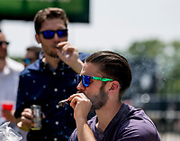 ELMONT, NY - JUNE 09: Fans enjoy cigars during Belmont Stakes Day at Belmont Park on June 9, 2018 in Elmont, New York. (Photo by Scott Serio/Eclipse Sportswire/Getty Images)