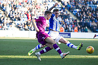 Regan Slater of Carlisle United clears despite the efforts of Sammie Szmodics of Colchester United during Colchester United vs Carlisle United, Sky Bet EFL League 2 Football at the JobServe Community Stadium on 23rd February 2019