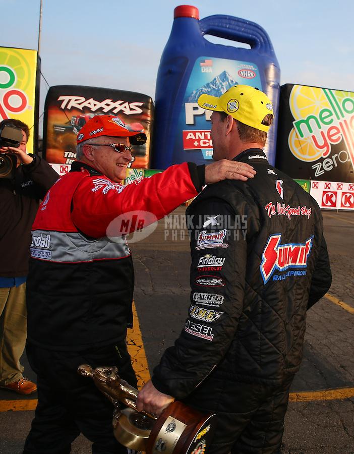 Feb 9, 2014; Pomona, CA, USA; NHRA pro stock runner up V. Gaines (left) congratulates NHRA pro stock driver Jason Line after winning the Winternationals at Auto Club Raceway at Pomona. Mandatory Credit: Mark J. Rebilas-