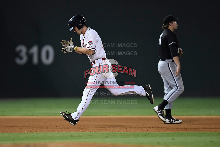 Right fielder Ryan Scott (30) of the Greenville Drive claps as he rounds the bases after hitting a home run in Game 3 of the South Atlantic League Championship series against the Kannapolis Intimidators on Thursday, September 14, 2017, at Fluor Field at the West End in Greenville, South Carolina. Jake Burger is in the background. Kannapolis won, 5-4. Greenville leads the series 2-1. (Tom Priddy/Four Seam Images)