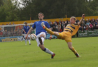 Lee Wallace wins possession ahead of Graham Fraser in the Forres Mechanics v Rangers William Hill Scottish Cup 2nd Round match, at Mosset Park, Forres on 29.9.12.