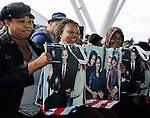September 22, 2012- Milwaukee, United States: Supporters show off Obama merchandise at a political rally at the Summerfest grounds. Thousands of Democrats showed up to attend the rally and cheer on Obama at his first visit to Wisconsin in months.
