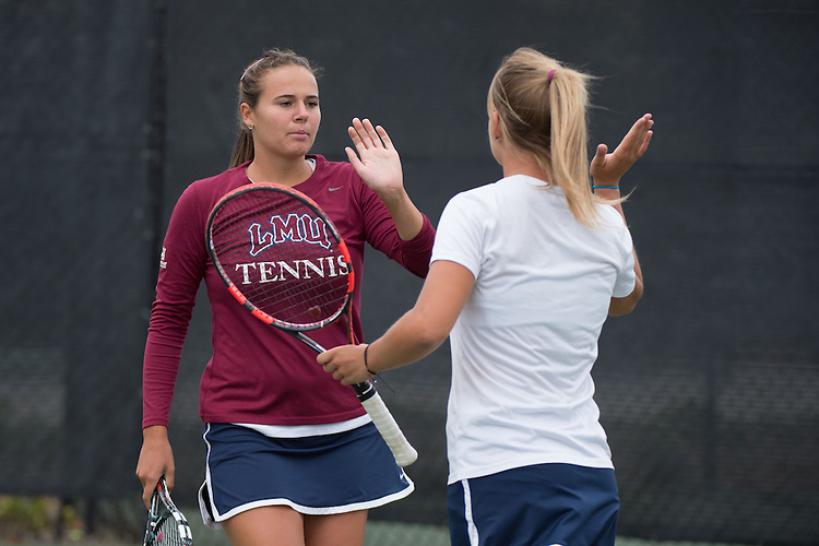 April 22, 2015; San Diego, CA, USA; Loyola Marymount Lions tennis players Julia Norlin (left) and Andrea Crespo (right) during the WCC Tennis Championships at Barnes Tennis Center.