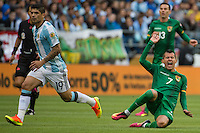 Seattle, WA - Tuesday June 14, 2016: Bolivia forward Juan Carlos Arce (7) reacts to being fouled during a Copa America Centenario Group D match between Argentina (ARG) and Bolivia (BOL) at CenturyLink Field