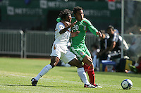 Rudel Calero (left) and Israel Martinez (20) battle for the ball. Mexico defeated Nicaragua 2-0 during the First Round of the 2009 CONCACAF Gold Cup at the Oakland, Coliseum in Oakland, California on July 5, 2009.
