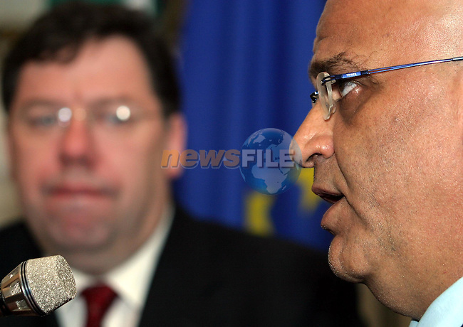 Dublin Ireland. THE OIC DELEGATION IS TRAVELLING TO THE CAPITALS OF THE FOUR QUARTET MEMBERS TO DISCUSS THE CURRENT SITUATION IN THE MIDDLE EAST PEACE PROCESS..BRIAN COWEN Irish Foreign Affairs Minister (L)  H.E. DR SAEB EREKAT, MINISTER IN CHARGE OF NEGOCIATIONS FOR THE PALESTINIAN AUTHORITY speaking at the press conference after the meeting at Iveagh House in Dublin 19/5/04.Photo AFP/NEWSFILE/Naoise Culanne..(Photo credit should read Naoise Culanne/NEWSFILE/AFP)...This Picture has been sent you under the condtions enclosed by:.Newsfile Ltd..the Studio,.Millmount Abbey,.Drogheda,.Co Meath..Ireland..Tel: +353(0)41-9871240.Fax: +353(0)41-9871260.GSM: +353(0)86-2500958.email: pictures@newsfile.ie.www.newsfile.ie.FTP: 193.120.102.198..This picture is from Fran Caffrey@newsfile.ie