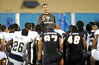30 March 2012:  FIU Football Head Coach Mario Cristobal addresses his players after the FIU Football Spring Game at University Park Stadium in Miami, Florida.
