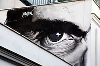 Titolo: L'occhio e' l'unico ad accorgersi della bellezza,  Artista Maupal<br /> Title: The eye is the only to notice beauty, Artist: Maupal<br /> Murale dedicato a Pierpaolo Pasolini. Il titolo e' tratto da un passo del poeta, dedicato al senso del bello e al mistero della visione. L'occhio di Paolini domina sul Pigneto, contemplando la bellezza di Roma.<br /> Mural dedicated to Pierpaolo Pasolini. The title is taken from an excerpt of the poet, dedicate to the sense of beauty and to the mystery of the vision. Pasolini's eye rules on the quarter, contemplating the beauty of Rome.<br /> Roma 01-02-2015 Street Art a Roma. In vari quartieri di Roma e' fiorita la Street Art, con splendidi murales che hanno lo scopo di raccontare delle storie della citta', di commemorare dei momenti importanti, o semplicemente di interpretarla.<br /> Street Art in Rome. Very important writers  painted Murales in various districts of Rome to tell stories about the city, to commemorate important moments, to embellish the quarter or simply to portray it.  <br /> Photo Samantha Zucchi Insidefoto