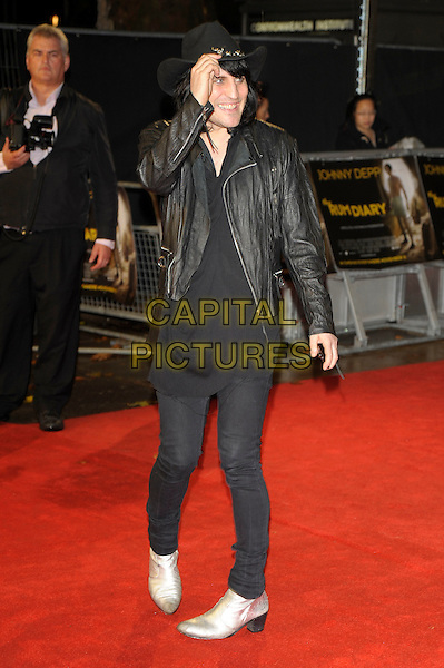 Noel Fielding.'The Rum Diary' European film premiere, Odeon Kensington cinema, London, England..3rd November 2011.full length black jeans denim top jacket hat gold silver boots hand arm.CAP/PL.©Phil Loftus/Capital Pictures.