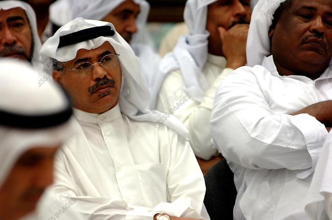 Men listened to a speech at an evening meeting at the National Democratic Action Society in Manama, Bahrain, December 14, 2005.