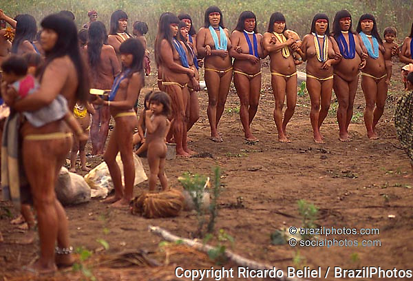 Waurá Indigenous People, Women dancing. Amazon rain forest, Brazil.