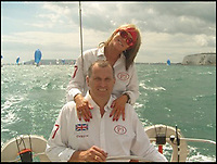 BNPS.co.uk (01202 558833)<br /> Pic:  BNPS<br /> <br /> Max Walker proposed to Rebecca Vowles using the sail of their boat during the Round the Island Race in 2009.<br /> <br /> The ex-fiancee of a millionaire businessman denied started a cat fight with his new girlfriend - because she 'loved her nails too much'.<br /> <br /> Rebecca Vowles, 47, said she couldn't have banged down a locked toilet cubicle door to attack terrified love rival Samantha Newby-Vincent as it might have damaged her immaculate nails.<br /> <br /> But magistrates found the glamorous blonde defendant guilty of assault after being shown a video recording of the attack that happened in the ladies' loos at an exclusive marina in Poole, Dorset.
