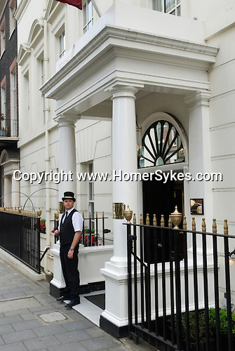 Doorman outside Crockfords in Curzon Street W1. Mayfair central London. City of Westminster. England 2006.