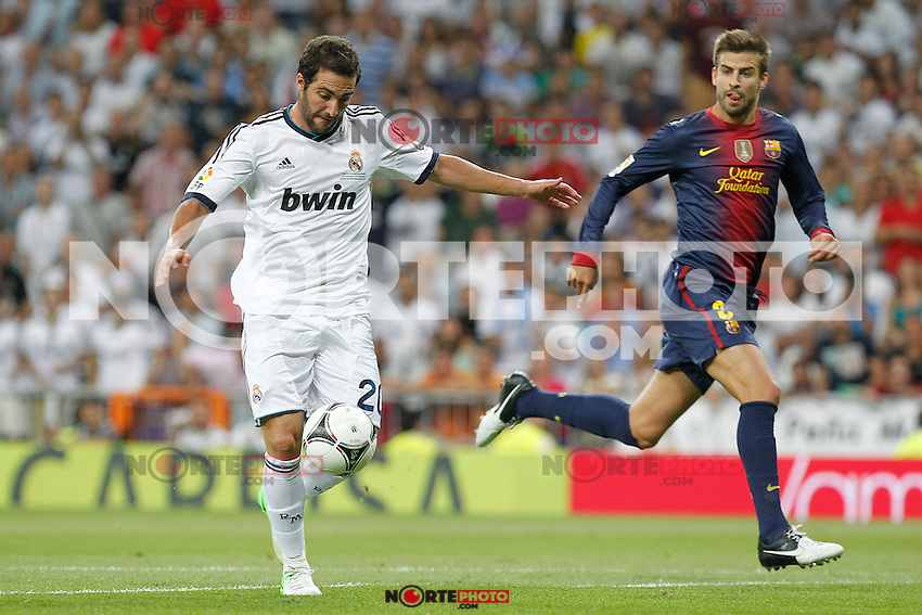 Real Madrid's Gonzalo Higuain and F.C. Barcelona's Gerard Pique during Spanish Supercup 2nd match on august 29 2012...Photo: Alex Cid-Fuentes / ALFAQUI /NortePhoto.com<br />